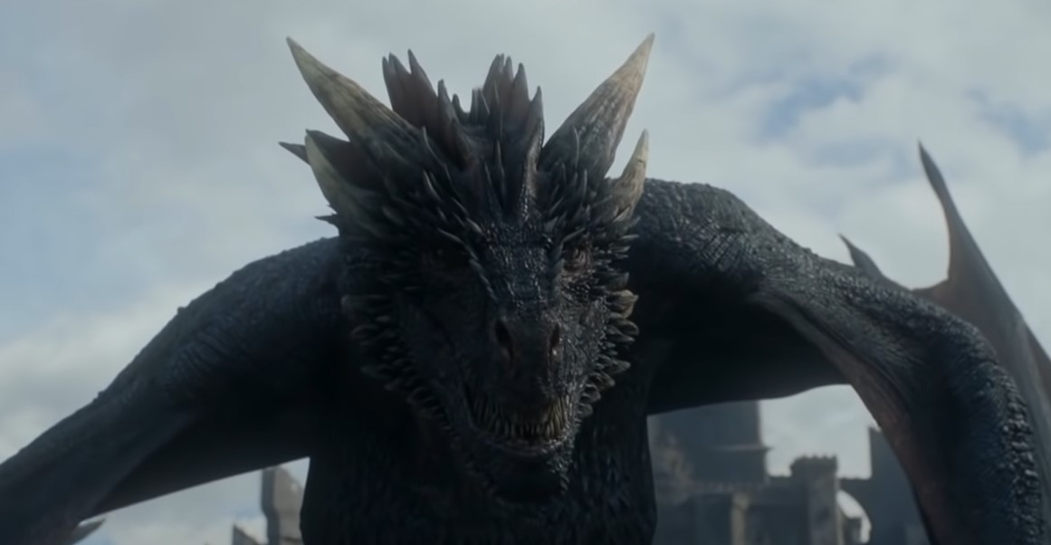 Game of Thrones Dragon in front of Jon Snow.