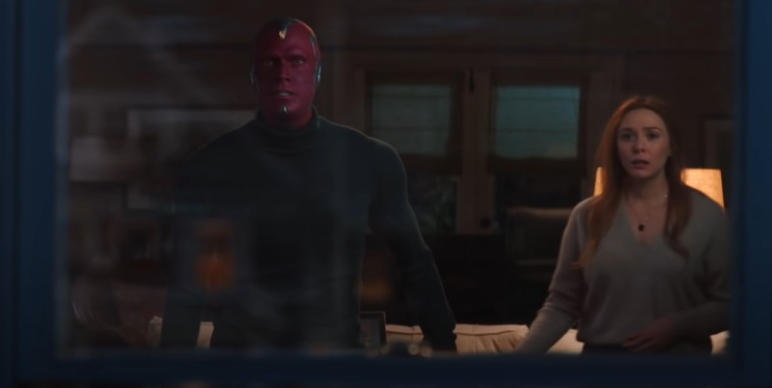 WandaVision Wanda Maximoff and Vision standing side-by-side.